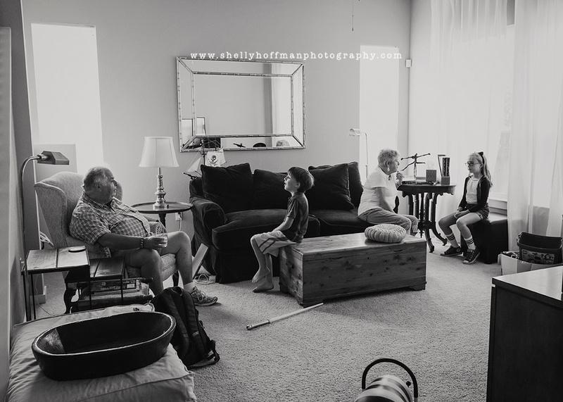 grandparents visit with grandchildren black and white photojournalism